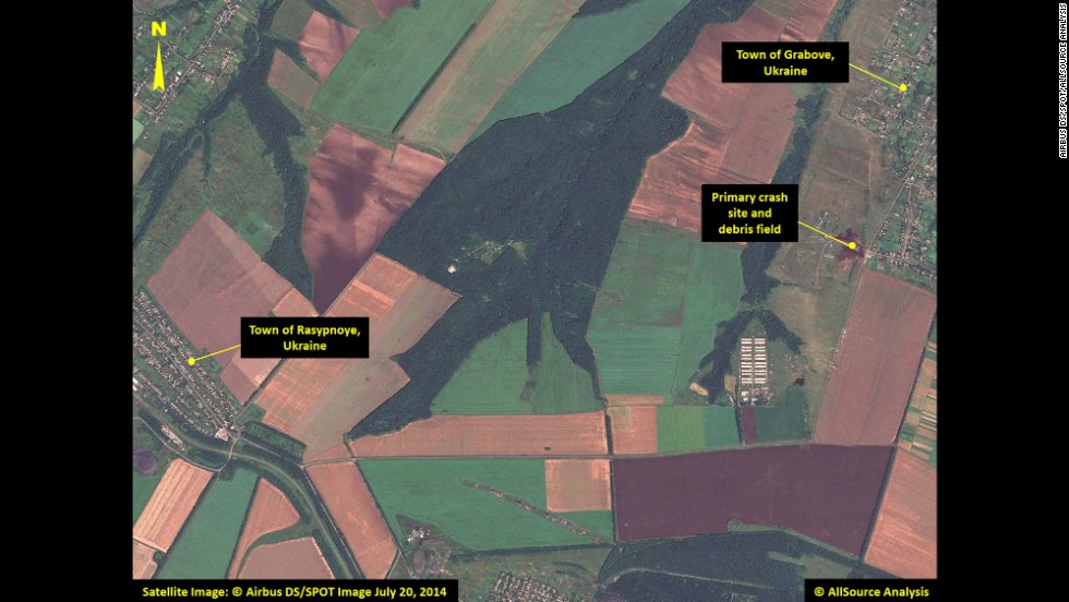 This satellite image shows the primary crash site of Malaysia Airlines Flight 17 between the towns of Hrabove (spelled Grabove in Russian) and Rasypnoye, Ukraine. The Boeing 777 was shot down Thursday, July 17, with a surface-to-air missile in Ukrainian territory controlled by pro-Russian rebels. All 298 people aboard died. The satellite imagery was collected on Sunday, July 20, by <a href=