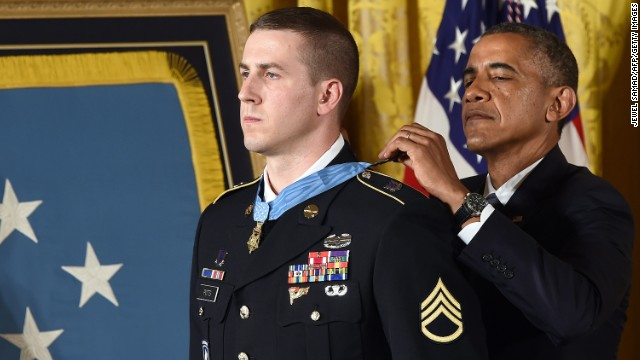 US President Barack Obama awards Ryan M. Pitts, a former active duty Army Staff Sergeant, the Medal of Honor for conspicuous gallantry in the East Room at the White House in Washington, DC, on July 21, 2014. Staff Sergeant Pitts received the Medal of Honor for his courageous actions while serving as a Forward Observer with 2nd Platoon, Chosen Company, 2nd Battalion (Airborne), 503rd Infantry Regiment, 173rd Airborne Brigade, during combat operations at Vehicle Patrol Base Kahler, in the vicinity of Wanat Village in Kunar Province, Afghanistan on July 13, 2008. AFP PHOTO/Jewel Samad        (Photo credit should read JEWEL SAMAD/AFP/Getty Images)