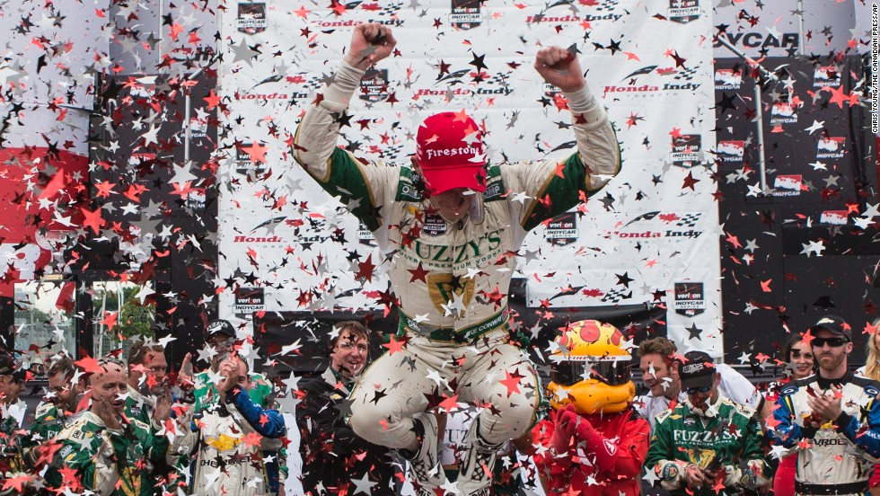 IndyCar driver Mike Conway leaps out of his car after winning a race in Toronto on Sunday, July 20. It was his second win of the season, which started March 30 and ends August 30.