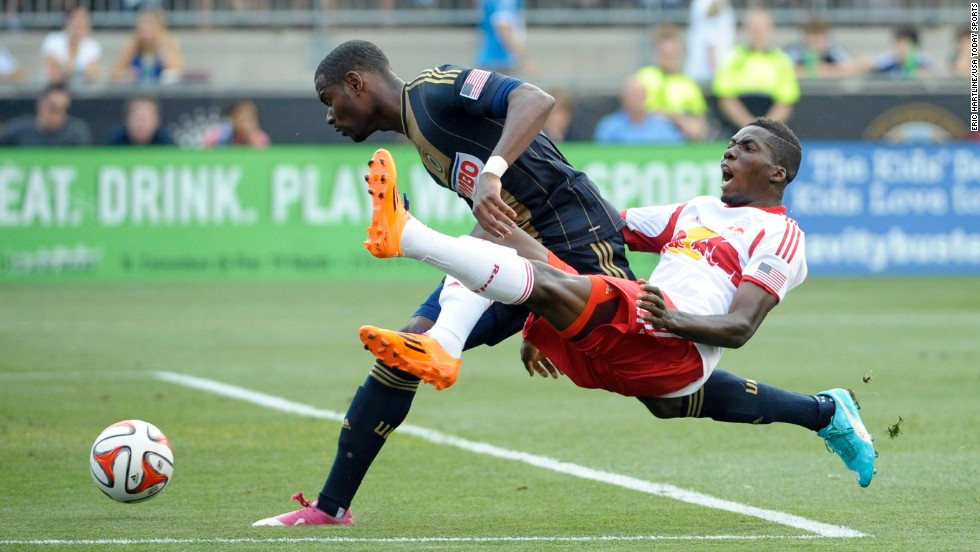 Philadelphia Union midfielder Maurice Edu, left, competes with New York Red Bulls defender Ambroise Oyongo during a Major League Soccer game Wednesday, July 16, in Philadelphia.