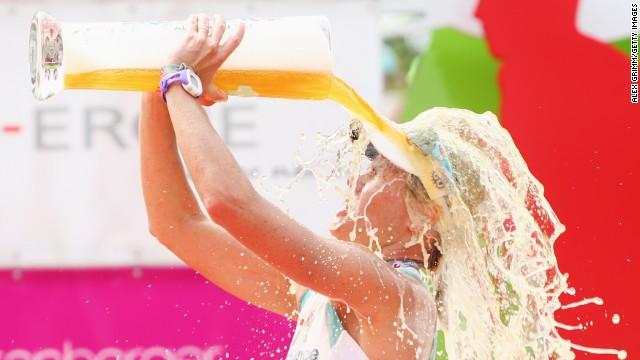 Mirinda Carfrae of Australia celebrates winning the Challenge Roth on July 20, 2014 in Roth, Germany.