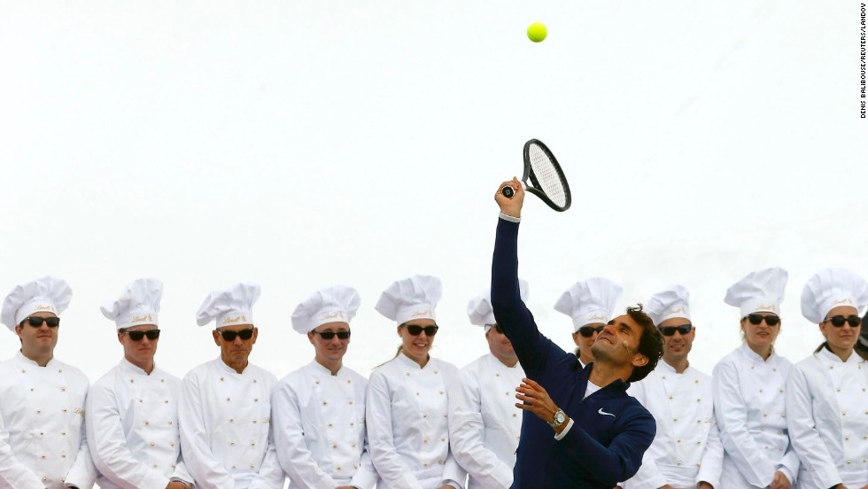 Swiss tennis player Roger Federer serves a ball to U.S. skier Lindsey Vonn during a promotional event on Switzerland's Aletsch Glacier on Wednesday, July 16. The two superstar athletes played tennis on a specially prepared court atop the glacier, more than 11,000 feet above sea level.