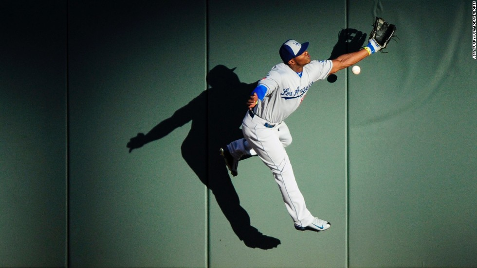 Los Angeles Dodgers outfielder Yasiel Puig is unable to catch a ball hit by Mike Trout during the Major League Baseball All-Star Game on Tuesday, July 15. Trout's triple helped him win the game's Most Valuable Player award as the American League triumphed 5-3.