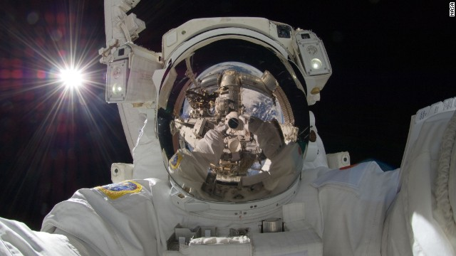Japan Aerospace Exploration Agency astronaut  Aki Hoshide took this breathtaking selfie during Expedition 32 on September 5, 2012. Using a digital stills camera while on the third spacewalk of the voyage, Hoshide reflects the Earth from his helmet visor.