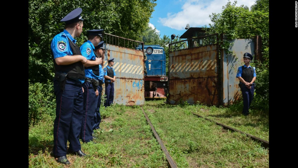 Police secure a refrigerated train loaded with bodies of passengers from Malaysia Airlines Flight 17 as it arrives in a Kharkiv, Ukraine, factory on Tuesday, July 22.
