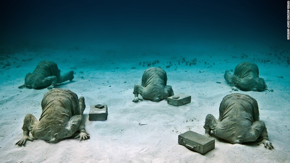 "<em>Bankers</em><br /><br />The artist doesn't shy away from a strong metaphor, such as the installation shown above where figures have their heads literally buried in sand: ""This was a piece referencing climate change and global warming, and how we tend to be living in denial at the moment, forgetting the future for short term gain,"" says Taylor, ""Caribbean has lost  so much of its natural reef, I think it really is a critical situation."""