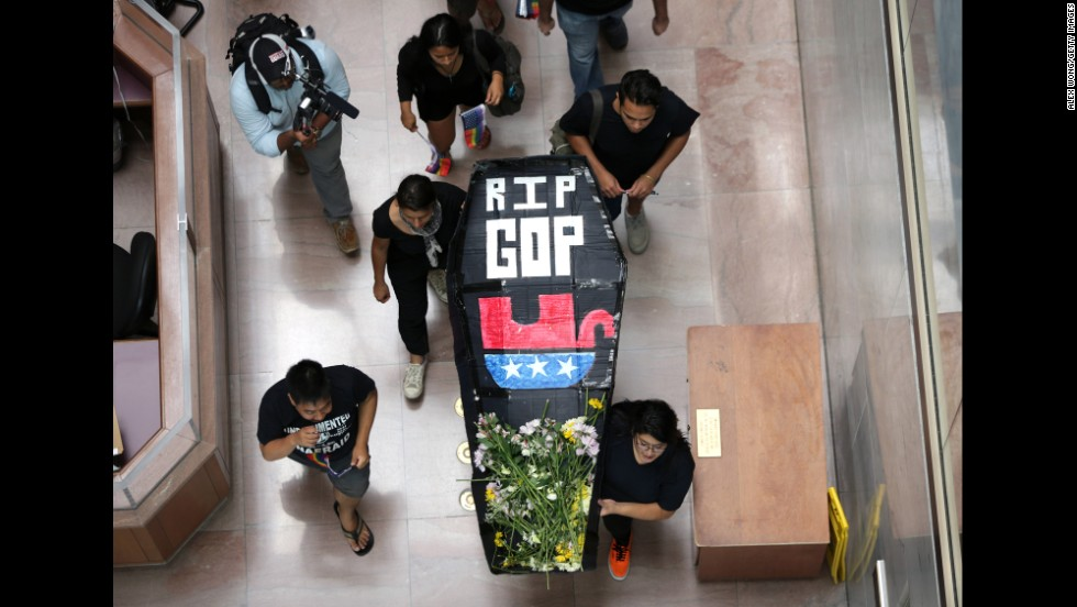 "Activists from the group United We Dream stage a mock funeral service for the Republican Party during a protest in Washington on July 21. They staged the funeral, they said, because ""the GOP has embraced radical right-wing policies and has actively called for the separation of families and the deportation of Dreamers."""