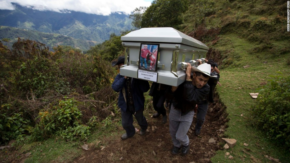 "Relatives carry the coffin of <a href=""http://www.cnn.com/2014/06/30/us/texas-border-death/"">Gilberto Francisco Ramos Juarez</a>, an 11-year-old Guatemalan boy whose decomposed body was found in Texas' Rio Grande Valley in June. The undocumented immigrant, who authorities believe may have died from heat stroke, was identified by a phone number on his belt buckle. A series of calls led to Gilberto's father, who described the clothes the boy was wearing."