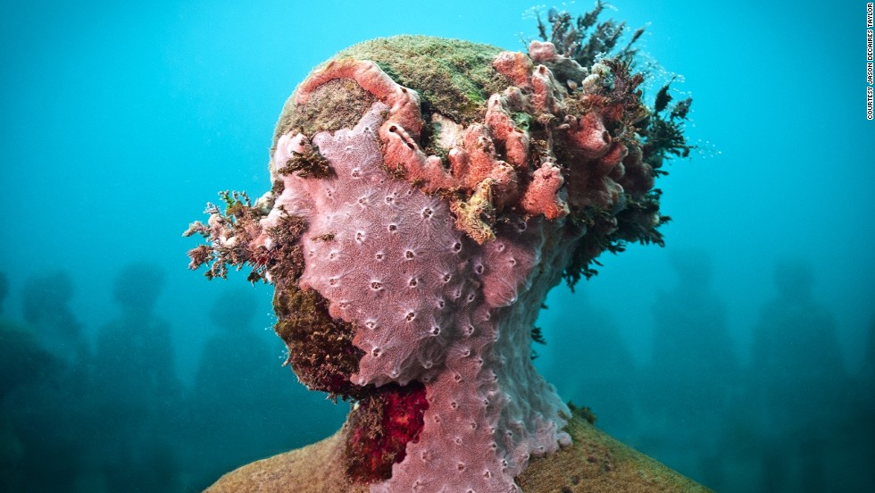 "<em>Vicissitudes</em><br /><br />Taylor plants corals on his figures, but says he never disturbs natural settings, instead using those grown in nurseries or damaged by tourists: ""I'm always trying to communicate how incredible this underwater world is, but also how it's under deep threat at the moment with climate change."" he says."