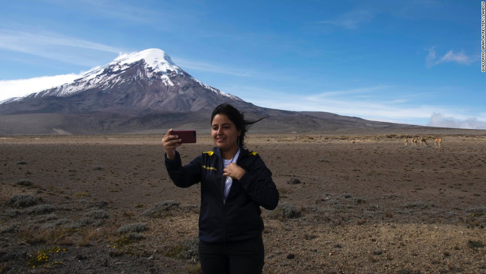 A woman takes a selfie with Ecuador's Mount Chimborazo on Friday, July 18. Chimborazo is the highest mountain in Ecuador, with a peak elevation of 20,564 feet.
