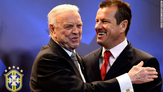 Brazil's new coach Dunga (R) with the country's football federation president Jose Maria Marin.