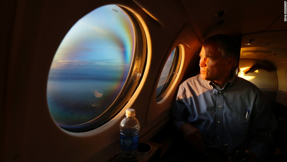 As the sun sets Friday, July 18, Washington Gov. Jay Inslee looks out his airplane window and sees smoke from the Chiwaukum Creek Fire near Leavenworth, Washington. Inslee was returning from a tour of areas affected by the wildfires.