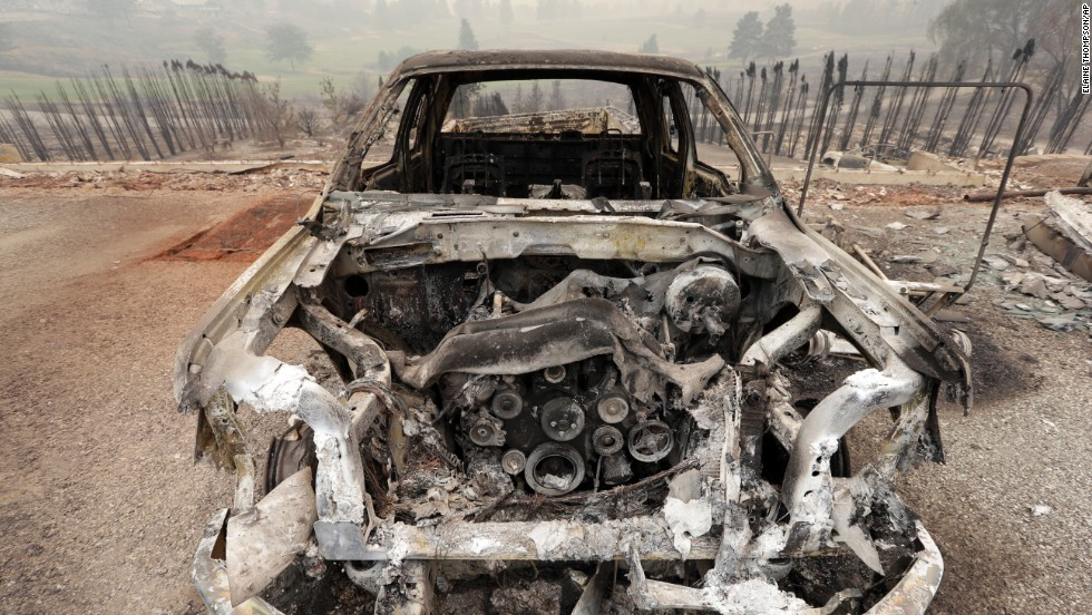 The shell of a burned-out car is seen July 18 in Pateros, Washington.