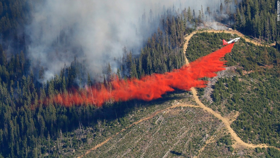 A plane drops fire retardant on the Chiwaukum Creek Fire near Leavenworth on Thursday, July 17.