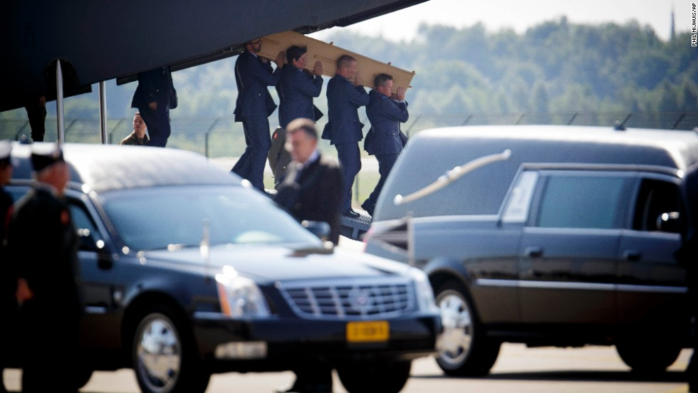 Military personnel in Eindhoven carry a coffin July 23 that holds one of the victims.