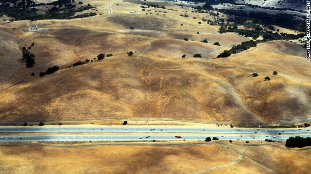 This picture taken from a helicopter shows a drought affected area near Los Altos Hills, California, on July 23. One of California's worst droughts in decades could cost the US state's farmers $1.7 billion, a recent study warned. The drought could leave 14,500 workers without jobs in California's Central Valley, known as America's food basket for providing vast supplies of fruit, vegetables and meat.