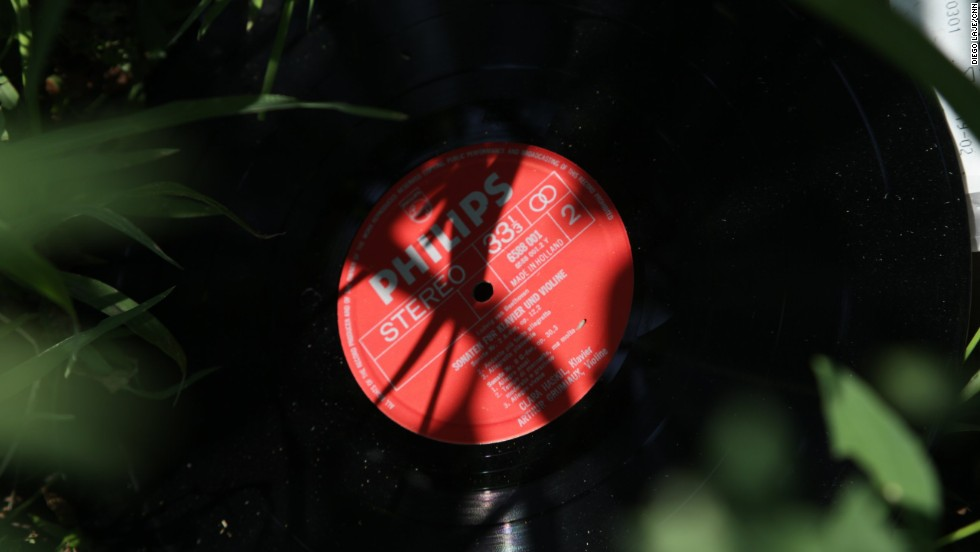 A classical music record is seen among the sunflowers on July 24.