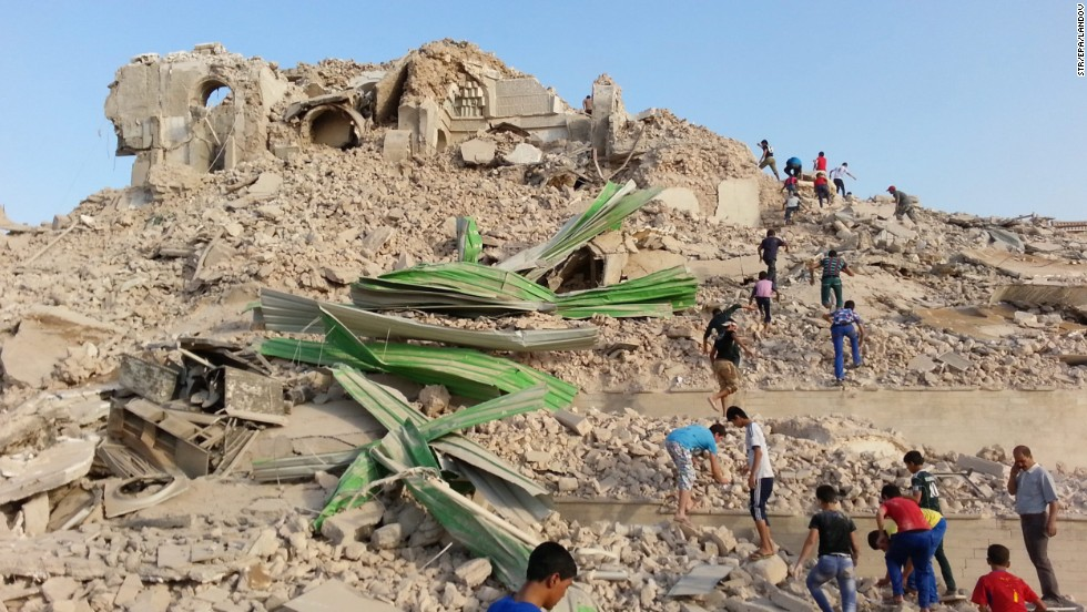 Iraqis inspect the wreckage of the grave of the prophet Jonah in Mosul. Even if the story of Jonah is more myth than fact, it remains an important symbol for Christians.