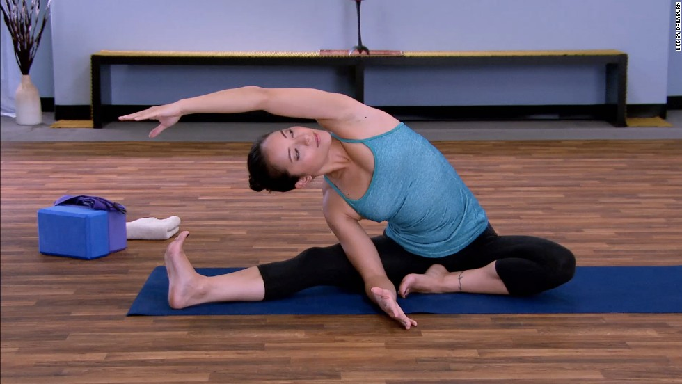 <strong>Seated Bend (One-Legged Upavistha Koasana): </strong>Fold toward the center and keep both feet flexed. Open your right shoulder and extend your arm up as you exhale. Fingertips should reach towards your opposite toes. Inhale, lengthen your spine, and press deeper on the exhalation. Inhale once again come to a seated position as you exhale.