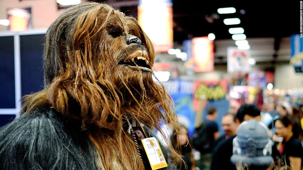 Christopher Petrone towers over fellow attendees in his handmade Chewbacca costume.