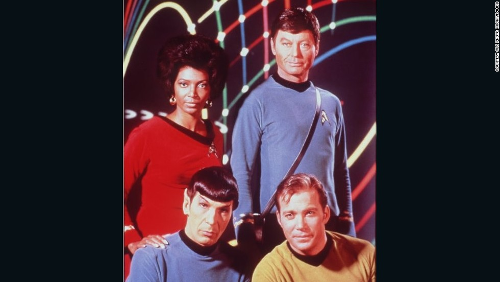 Leonard Nimoy, William Shatner, DeForest Kelley and Nichelle Nichols, from the original Star Trek series. Dr. McCoy, top right, is carrying that show's version of the Tricorder.