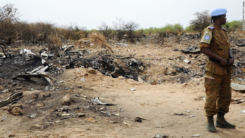 "A United Nations soldier stands at the crash site of Air Algerie Flight 5017 on Saturday, July 26. A U.N. spokeswoman says a second flight data from the DC-83 was recovered on Saturday. The flight, carrying 116 people when it took off from Burkina Faso on July 24 bound for Algiers, crashed in Mali's Gossi region, west of Gao. ""Regrettably, there were no survivors,"" said French President Francois Hollande."