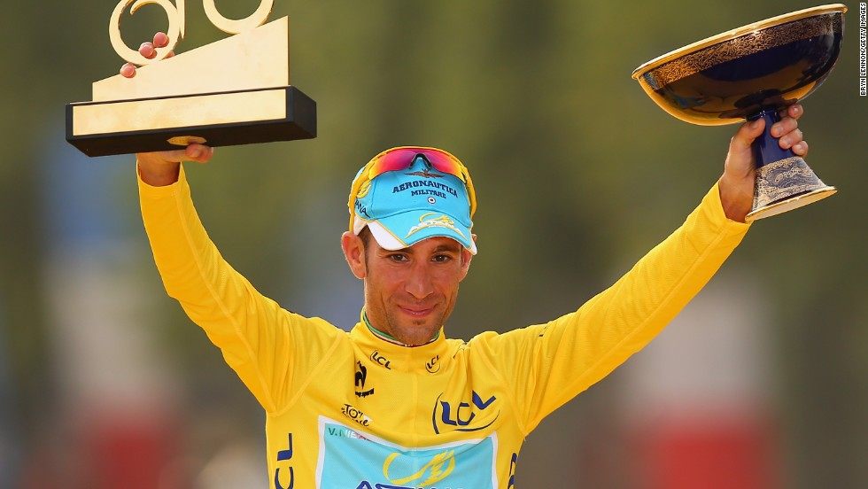 Vicenzo Nibali celebrates his victory on the podium of the Tour de France in Paris.