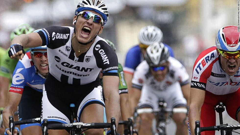 Marcel Kittel of Germany celebrates after claiming the prestigious final stage of the Tour de France on the Champs Elysees.