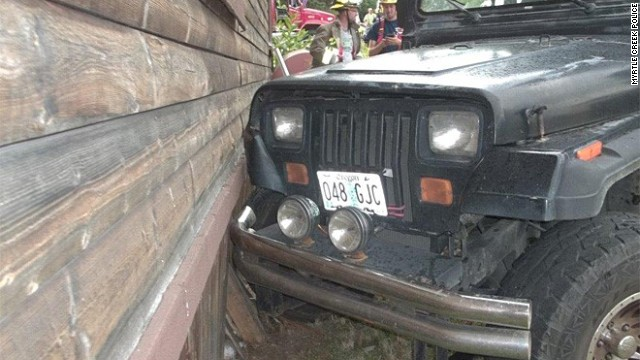 A 3-year-old crashed a Jeep into a home in Myrtle Creek, Oregon July 22, 2014.