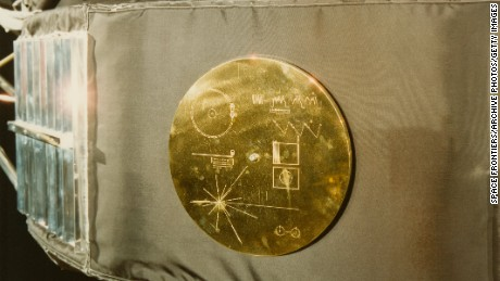 "A gold record in its cover attached to a Voyager 1 space probe. The record, entitled ""The Sounds Of Earth"" contains a selection of recordings of life and culture on Earth. The cover also contains instructions for any extraterrestrial being wishing to play the record."