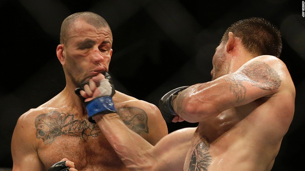 Tim Means punches Hernani Perpetuo during a UFC event held Saturday, July 26, in San Jose, California. Means won the welterweight bout by unanimous decision.