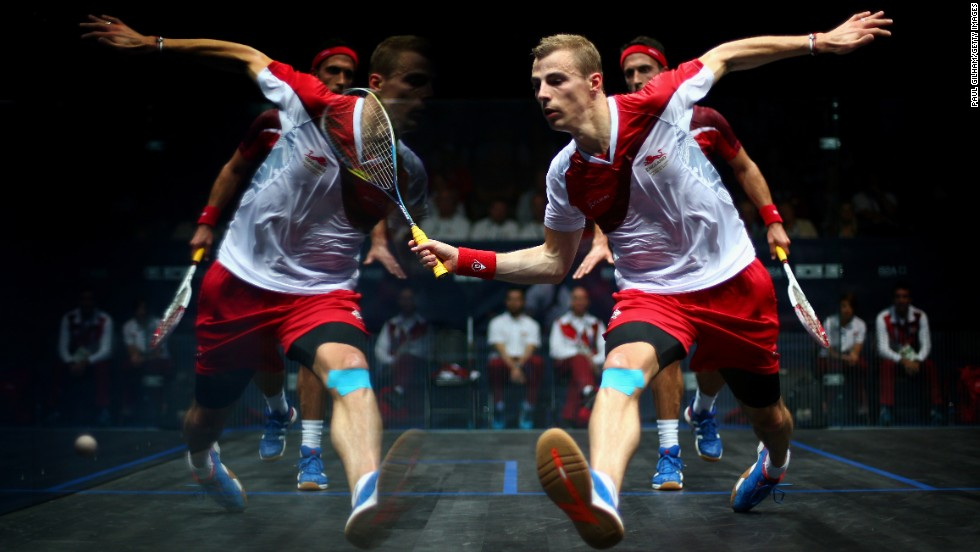 The reflection of squash player Nick Matthew is seen on the court's glass walls as he plays a shot against fellow Englishman Peter Barker in a semifinal match Sunday, July 27, at the Commonwealth Games in Glasgow, Scotland. Matthew advanced to the final, where he defeated another compatriot, James Willstrop, to win gold.