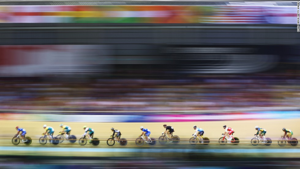 In this photo, which was shot using a slow shutter speed, cyclists compete in a qualifying heat for the men's 40-kilometer points race Saturday, July 26, at the Commonwealth Games in Glasgow, Scotland. New Zealand's Thomas Scully won gold in the event.