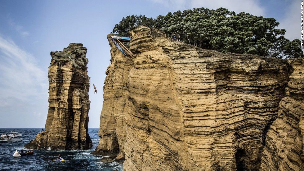 David Colturi of the United States dives from a 27-meter platform on the Islet of Vila Franca do Campo, which is in Portugal's Azores region, on Saturday, July 26. Colturi finished third in what was the fifth stop of the Red Bull Cliff Diving World Series.