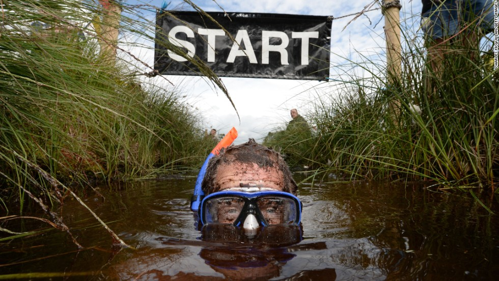 Stephen McDonagh takes part in the Irish Bog Snorkeling Championship held Sunday, July 27, at Peatlands Park in Dungannon, Northern Ireland. The annual event has male and female competitors swim the 60-meter length of the bog as they're watched by scores of spectators.