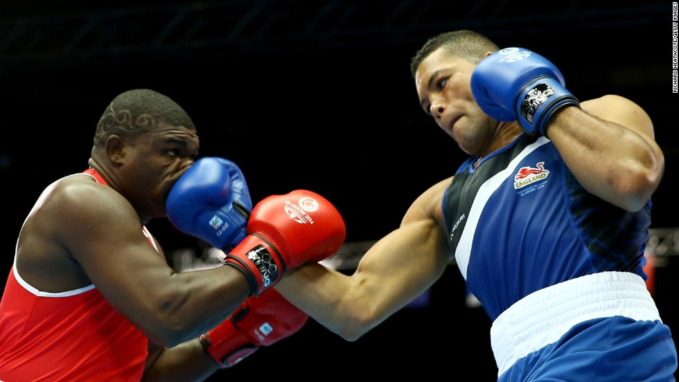 Joseph Joyce of England, right, boxes Keddy Agnes of Seychelles in the super heavyweight preliminaries Friday, July 25, at the Commonwealth Games in Glasgow, Scotland. Joyce won by unanimous decision to advance to the quarterfinals.