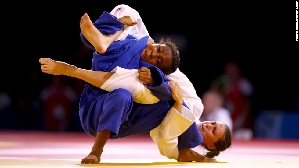 Scotland's Kimberley Renicks, in white, defeats Cameroon's Marcelle Monabang in a judo match Thursday, July 24, at the Commonwealth Games in Glasgow, Scotland. Renicks would go on to win the gold medal in her weight class.