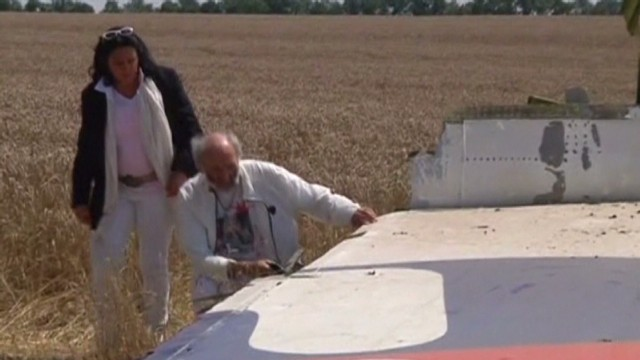 First family reach MH17 crash site