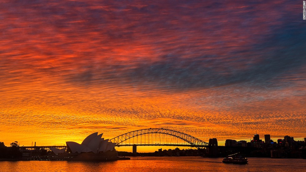 "Sydney residents enjoyed a stunning sunset Monday night, and took to social media to share their favorite shots. Photographer <a href=""http://facebook.com/hirstyphotos"" target=""_blank"">Richard Hirsty</a> captures the Sydney Opera House and Sydney Harbour against a florescent sky."