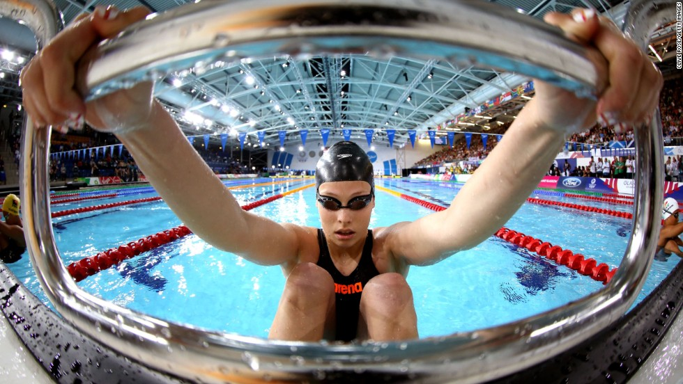 """GLASGOW, SCOTLAND - JULY 28: Courtney Butcher of Guernsey prepares to compete in the Women's 50m backstroke during day five of the Glasgow 2014 Commonwealth Games. <a href=""""http://edition.cnn.com/2014/07/23/sport/commonwealth-games-glasgow-queen-bolt/"""">Athletes representing the 71 nations and territories of the Commonwealth</a> compete in the event."""