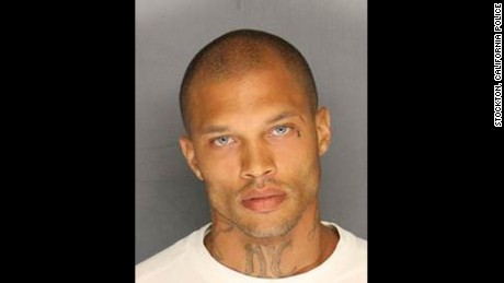 """Meet Jeremy Meeks. Convicted felon. Reoffender.   And according to his lady fans, he should have tried a career in modeling instead of street crime.   His Stockton Police mug shot has garnered over 13,000 Facebook Likes and over 3,000 comments in less than 24 hours.  Wiha Marlene said, """"Omg he's waaaaay to sexy to go in a cell. Bring him to me I'll lock him up"""" And Salma Hadad, """"Being that sexy is obviously illegal"""" Ashleigh Patia wrote, """"I'm so confused he's so hott. ..I totally missed the fact it was a mugshot.lol...aaaahhhh drooling""""  Some of the women are even discussing the idea of pitching in for his $900,000 bail.  """"Lets all pitch in for his bail ladies!!!"""" wrote Katie Bug.  Meeks, 30, faces six felony counts related to street terrorism and weapons charges.  He is due in the Stockton Courthouse tomorrow, Friday."""