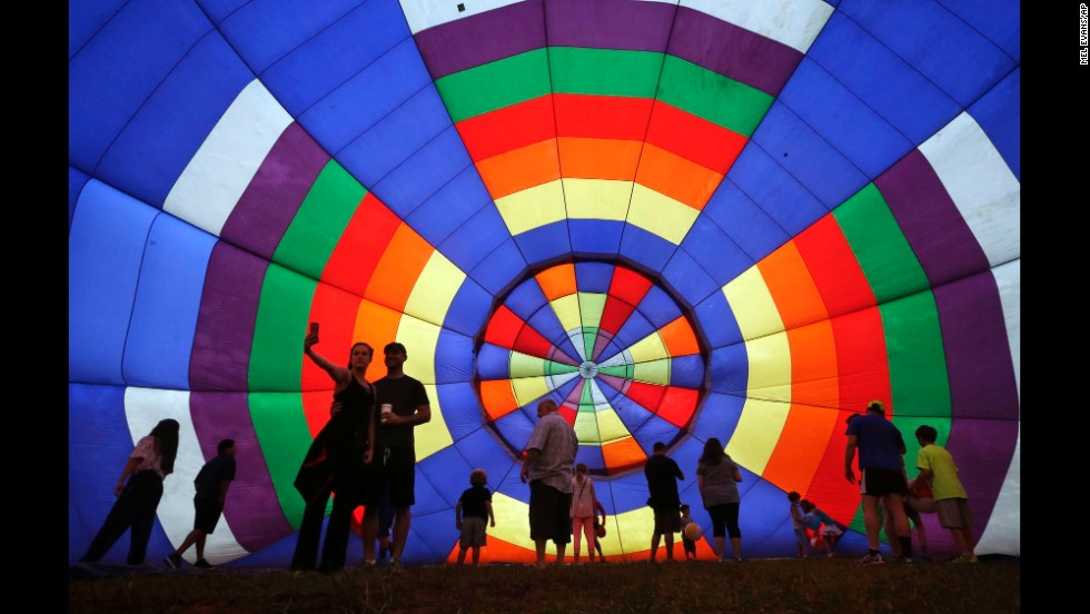 People walk around a partially inflated hot-air balloon Sunday, July 27, at the 32nd annual New Jersey Festival of Ballooning in Readington, New Jersey.