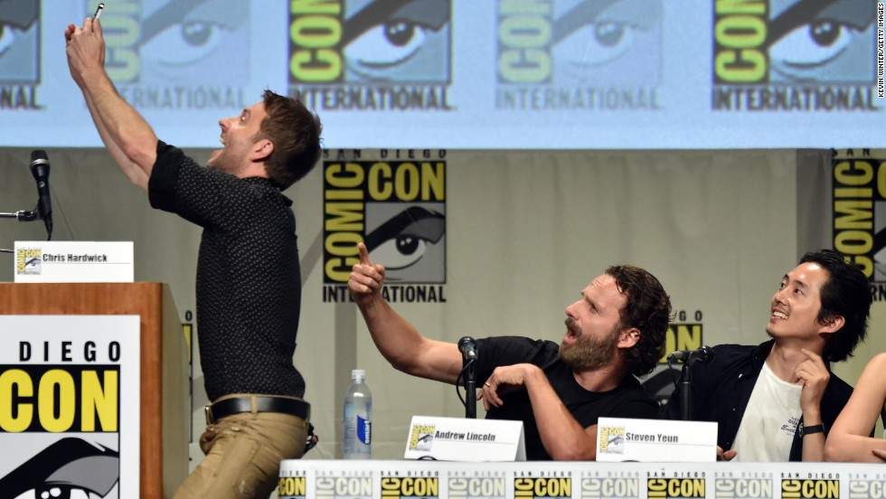 "Television personality Chris Hardwick takes a selfie with actors Andrew Lincoln and Steven Yeun during San Diego's Comic-Con on Friday, July 25. Hardwick was hosting a panel for AMC's hit show ""The Walking Dead."""