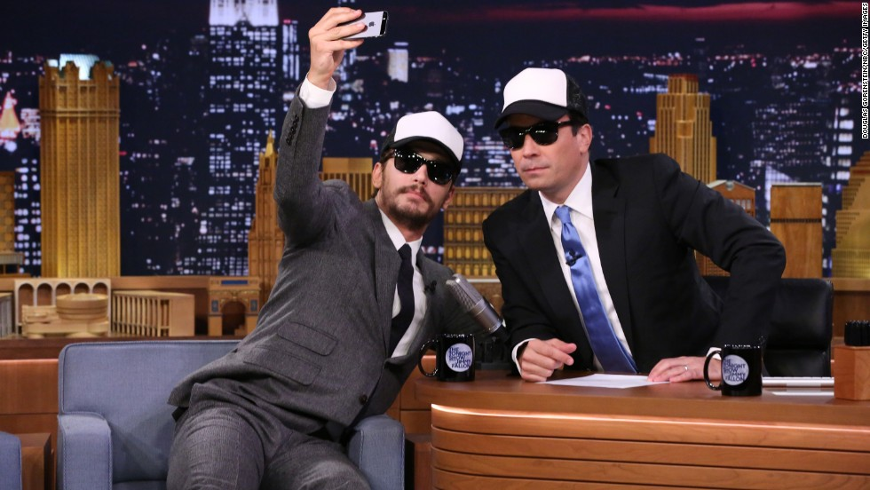 "Actor James Franco snaps a selfie with host Jimmy Fallon on a ""Tonight Show"" episode Monday, July 28."