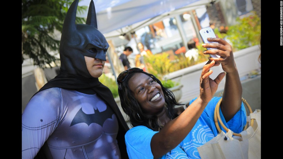 Yozan Brown takes a selfie with Batman at Comic-Con on Thursday, July 24.