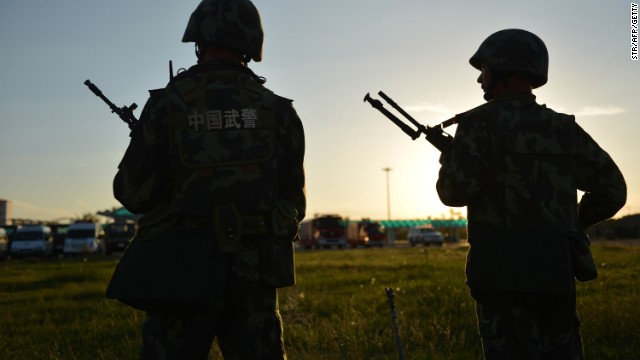 File: Anti-terrorism police attend an exercise in China's Xinjiang region in 2013.