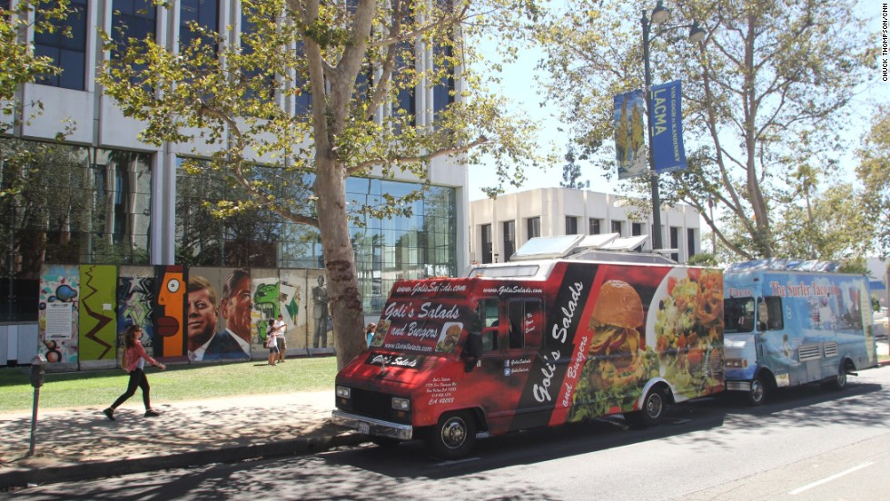 Food trucks often congregate near 5900 Wilshire Boulevard, where the largest stretch of the Berlin Wall (background) outside of Germany is on public display. The Los Angeles County Museum of Art is across the street.
