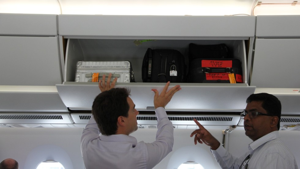 The manufacturer touts increased luggage space in the overhead bins. Side stowage areas can fit five roller bags.