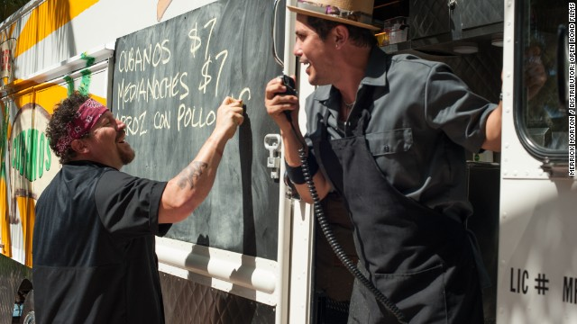 "In ""Chef,"" Jon Favreau and John Leguizamo are peppy partners in a food truck business."