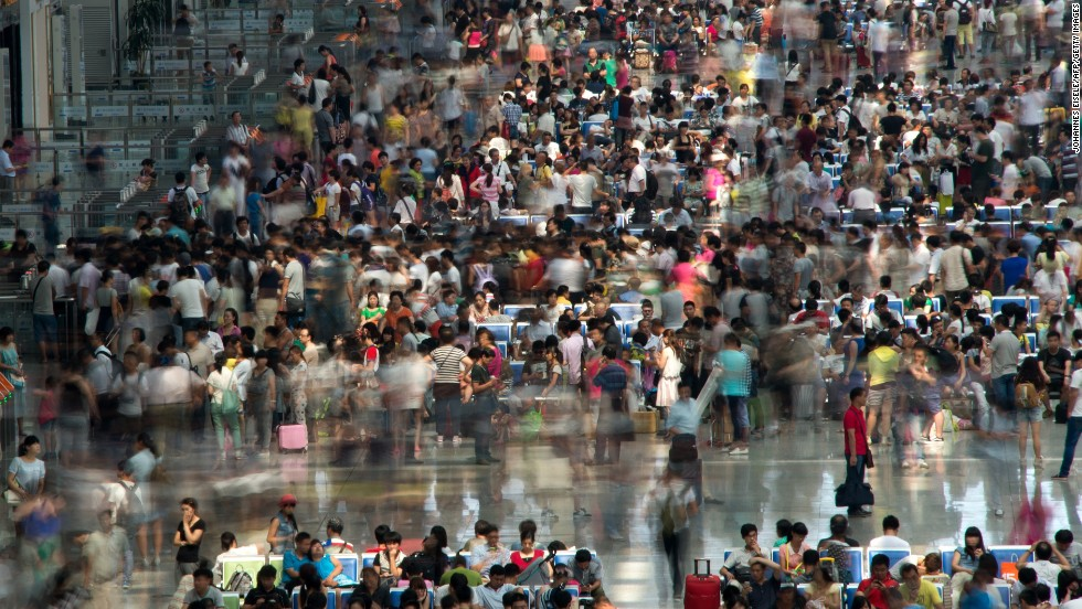 """JULY 30 - SHANGHAI, CHINA: Crowds of passengers fill the waiting hall at Hongqiao Railway Station which services Shanghai International Airport. <a href=""""http://edition.cnn.com/2014/07/22/travel/china-airports-disruptions/"""">Eastern China has been experiencing severe delays and travel disruption</a> for over two weeks now, due to airspace military exercise."""